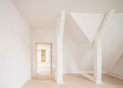 Studiomama pairs pale wood with marble for revamped loft in Stockholm