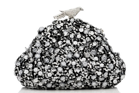 Judith Leiber Black Stardust bag is secured with a crystal bird