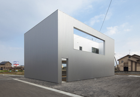 Metal-clad house in Japan by Eto Kenta conceals its garden