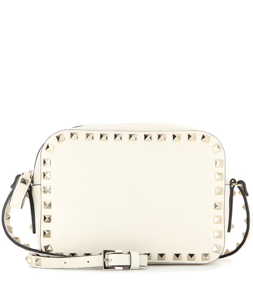 mytheresa.com - Rockstud leather cross-body bag - Current week - New Arrivals - Luxury Fashion for Women / Designer clothing, shoes, bags