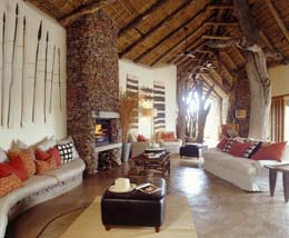 Makanyane Safari Lodge - African Safari Holidays, Accommodation in 8 luxury suites. Located in the Madikwe Game Reserve in South Africa with facilities for weddings and conferences. In a malaria-free area with lush riverside forest, with the Big 5 game species and many other wildlife species.