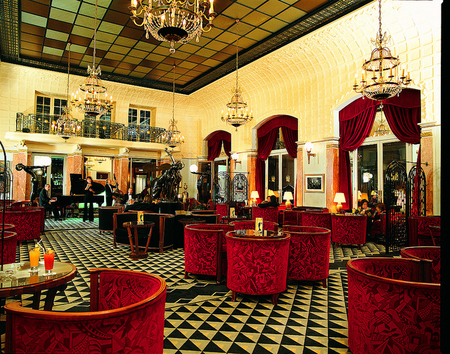 paris rive gauche france art deco interior design with red seats
