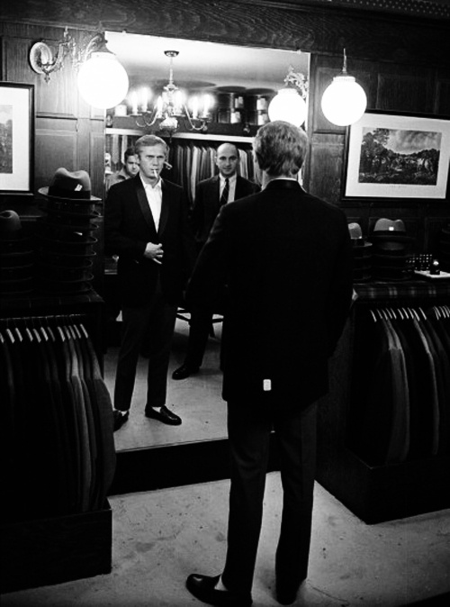 Steve McQueen checks out his reflection as he tries on ... | Stay Cla…
