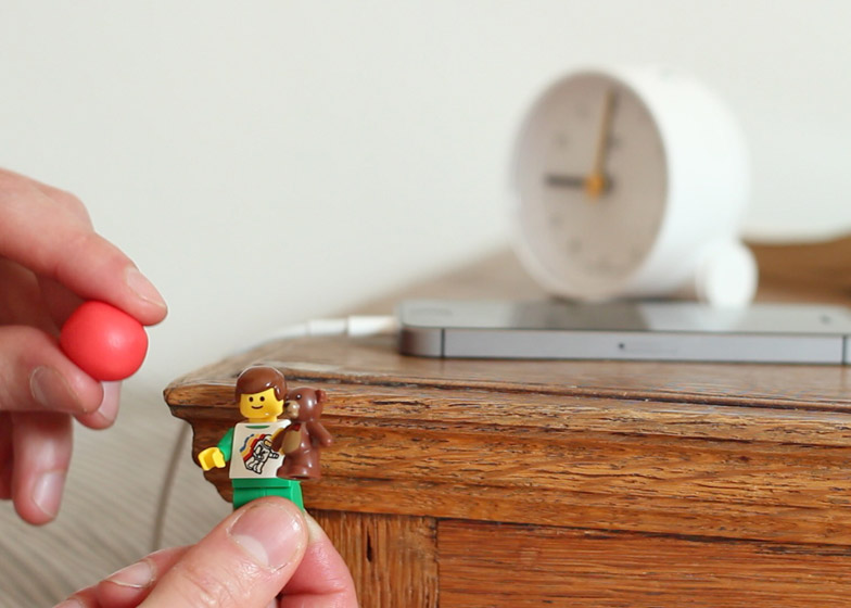 Lego figurines provide makeshift holders for Apple Firewire cables