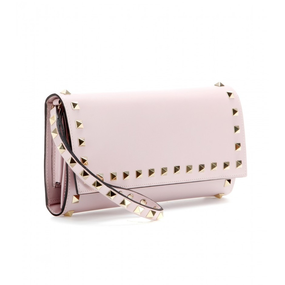 mytheresa.com - Rockstud leather clutch - current week - new arrivals - Luxury Fashion for Women / Designer clothing, shoes, bags