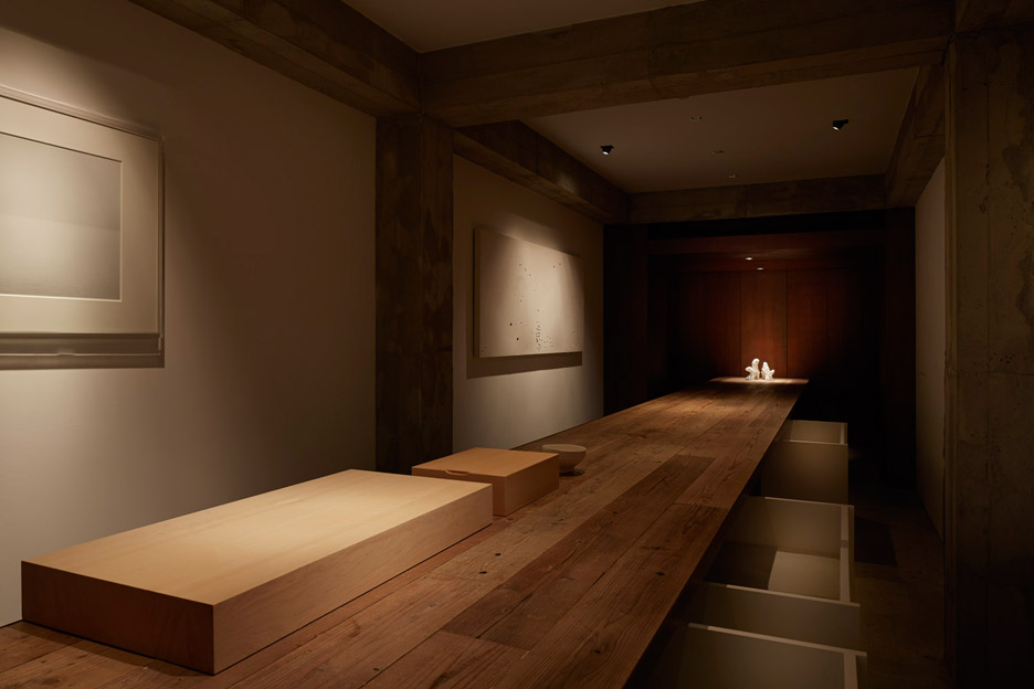 Suppose Design Office adds spotlit stage to sushi restaurant