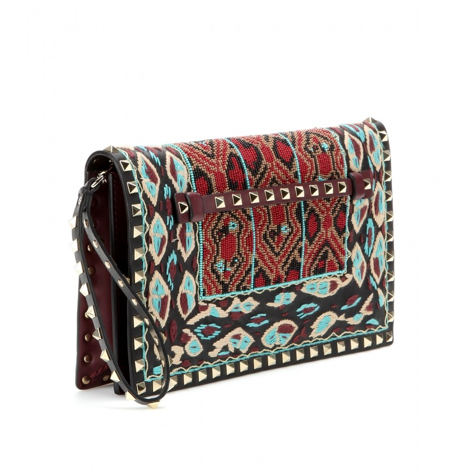 mytheresa.com - Rockstud embroidered and bead-embellished leather clutch - Current week - New Arrivals - Luxury Fashion for Women / Designer clothing, shoes, bags