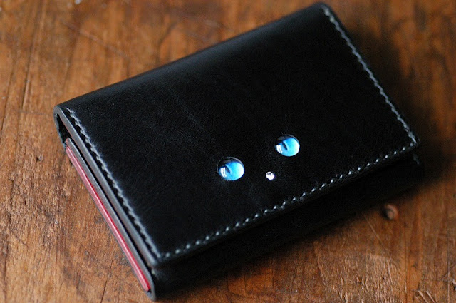 Jinen Design leather work: CAT GLASS EYES