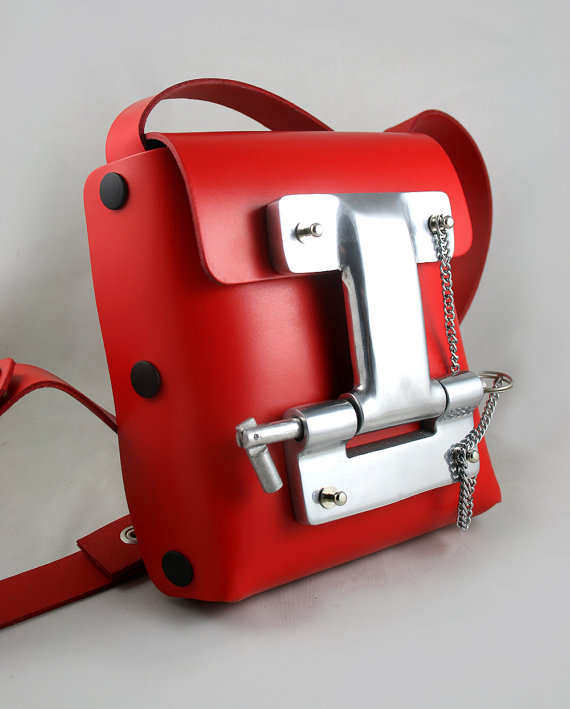 small red leather cross body bag unusual buckle by hitekdesigns