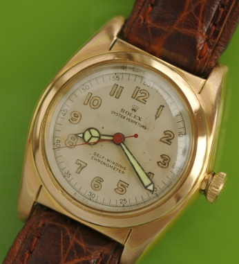 ROLEX OYSTER BUBBLEBACK TROPICAL dating to 1948 vintage watch @ WatchesToBuy.com