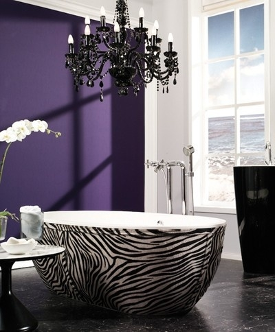 Zebra tub and black chandelier with purple accent