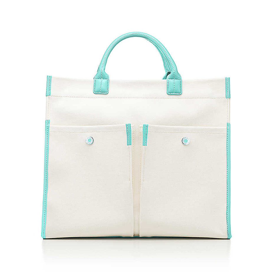 Jitney tote in natural canvas and Tiffany Blue® grain leather. More colors avail   Tiffany & Co.
