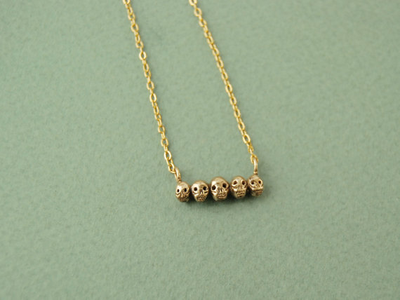 Tiny golden skull necklace by datter on Etsy