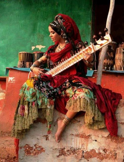 woman playing the sitar in India | Sitar | Pinterest
