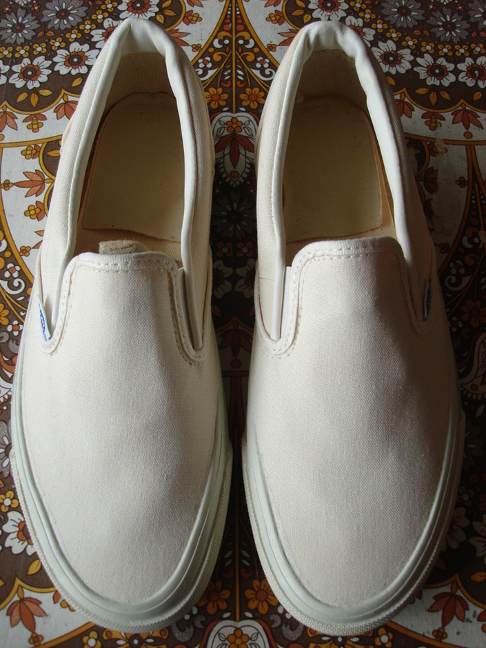 theothersideofthepillow — vintage VANS solid white white canvas SLIP-ON style #98 MADE IN USA 1980's off the wall US6.5