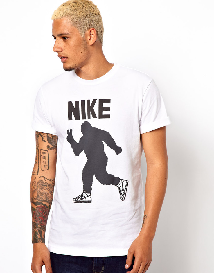 Nike | Nike T-Shirt with Peace Out Yeti Graphic at ASOS