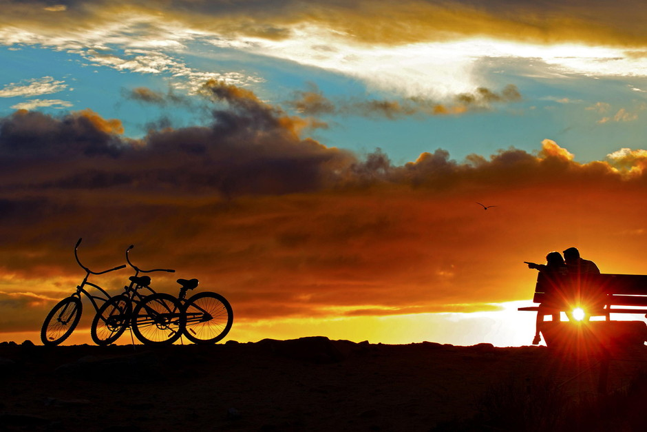 500px / A Couple with Two Bikes at Sunset in Dana Point. by Rich Cruse
