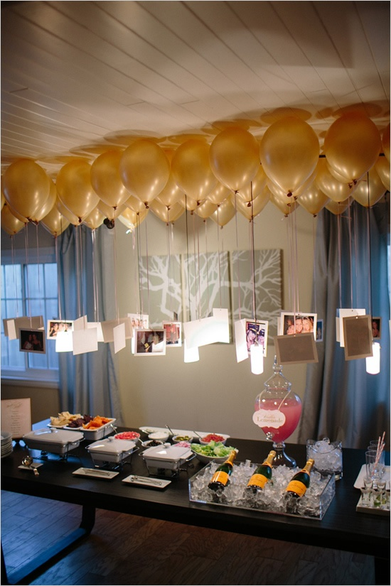 Photos hanging from balloons to create a ... | Holiday Party Ideas