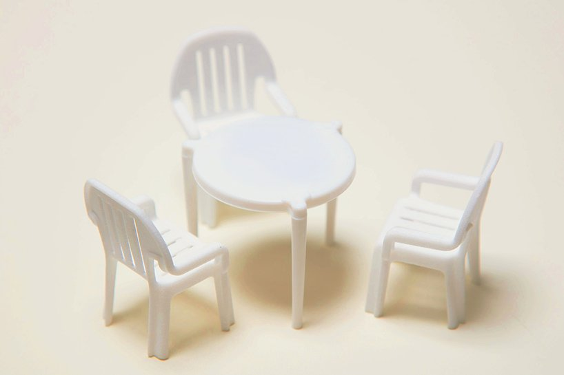 finally, that little plastic pizza table has its own tiny takeout patio chairs