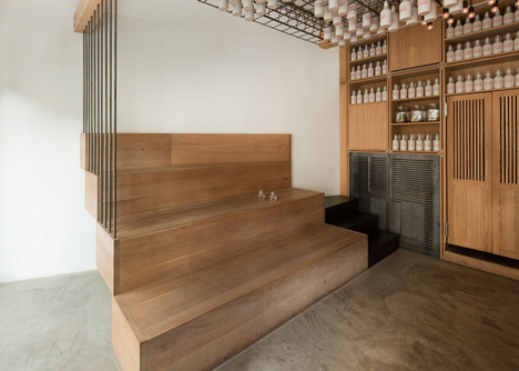 Buero Wagner suspends ingredient bottles from a cocktail bar ceiling