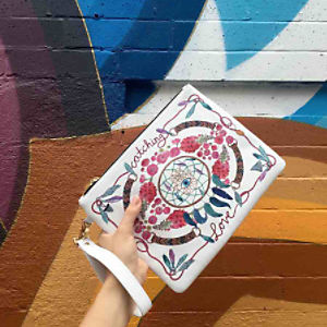 Emm Kuo x Chrisu Infinite Love Clutch at Free People Clothing Boutique