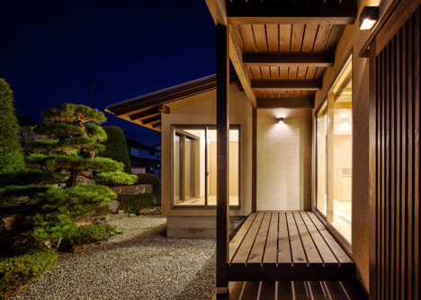 Criss-crossing wooden beams fill a void inside Cocoon House