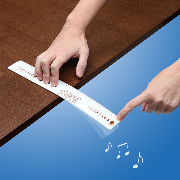 ThinkGeek :: Musical Ruler with Songbook