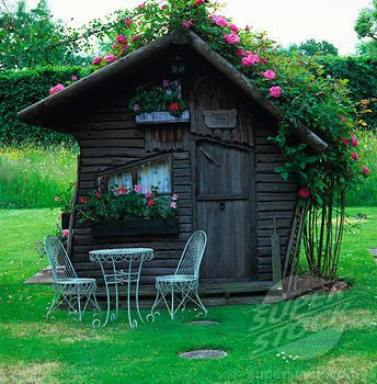 Nicknamed ÔShorter End CottageÕ, this quirky summerhouse is the childrenÕs former playhouse. Rosa Zephirine DrouhinÕ climbing onto roof. | Stock Photo 4287-6304 : Superstock