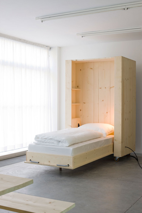 Harry Thaler adds mobile furniture and boxy beds to artists' apartment