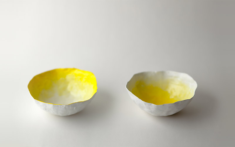 up in the air somewhere   paper vessels   small yellow bowls