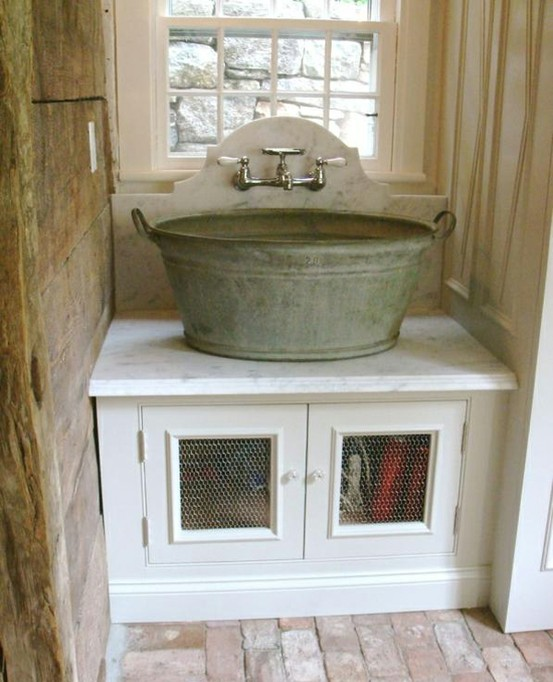 interior / Wash bucket sink with wall mount faucet.