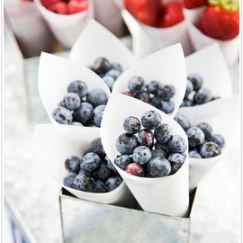 Ripe berries artfully arranged in crisp white cones