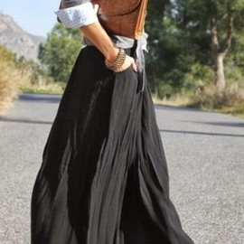 street - Fall fashion trend with black long skirt