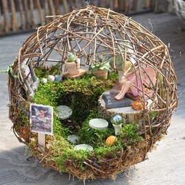 Fairy garden inside a small sphere