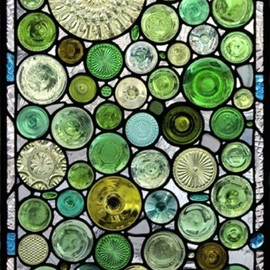 the bottoms of bottles and old glass serving dishes used to make windows. Freaking gorgeous.