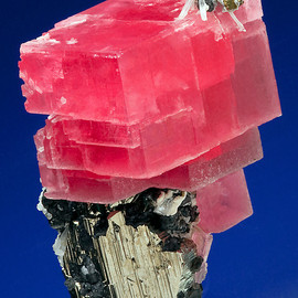 Rhodochrosite atop a large Pyrite with Tetrahedrite and Quartz