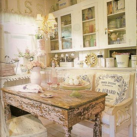shabby chic kitchen: i love the pastel little things in the cabinet.also, the table.