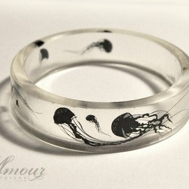 Float On - clear resin bangle featuring little jellyfish silhouettes.