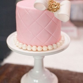 Pink cake with a white bow