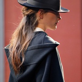 Hermes - Black hat and hooded coat , Fall 2012. |