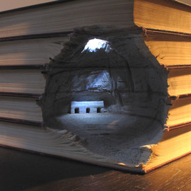 Book Sculptures, carved into stacks of reference books