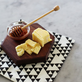handcrafted by either Sarah Sherman Samuel or her father, Lee - walnut serving board | hexagon