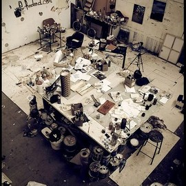 an artist working in his studio