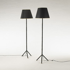 Floor lamps, pair by Jacques Adnet