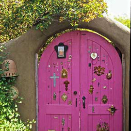 Pink doorway decorated with milagros, Santa Fe, New Mexico
