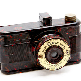 Candid Cinex marbleized bakelite camera from 1940s