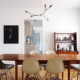 Eames chairs, teak table, vintage pottery collection, portrait art and DIY light fixture