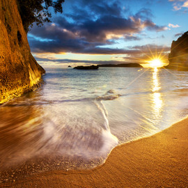 New Zealand, - Photograph Cathedral Cove Beach Sunrise Starburst - New Zealand by Daniel Peckham on 500px