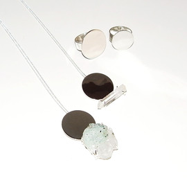 in her - in her Circle stone necklaces