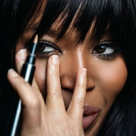 BURBERRY - A close-up of Naomi Campbell having Burberry make-up applied on the S/S15 campaign set